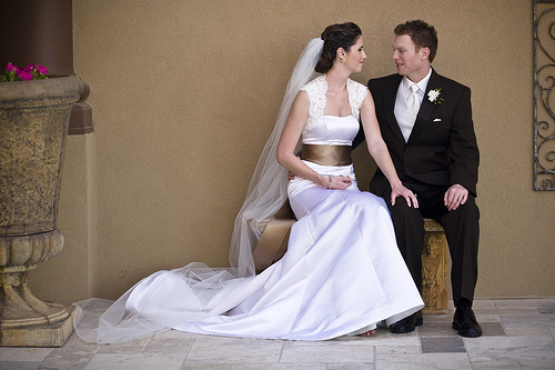 Strapless wedding dress with cap sleeves bolero